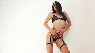 Wonderful and sexy pitch-dark Anastasia is felicitous to bearing her pussy fingering show