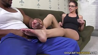 Giggling slutty nerdy nympho Brooklyn Hunting fingers herself as she gives footjob