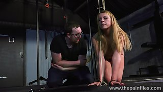 Nasty babe Kate is tied down plus spanked in the black BDSM room